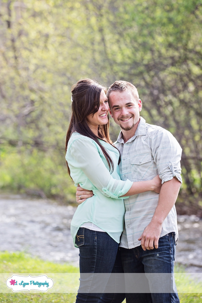 couple laughing near river