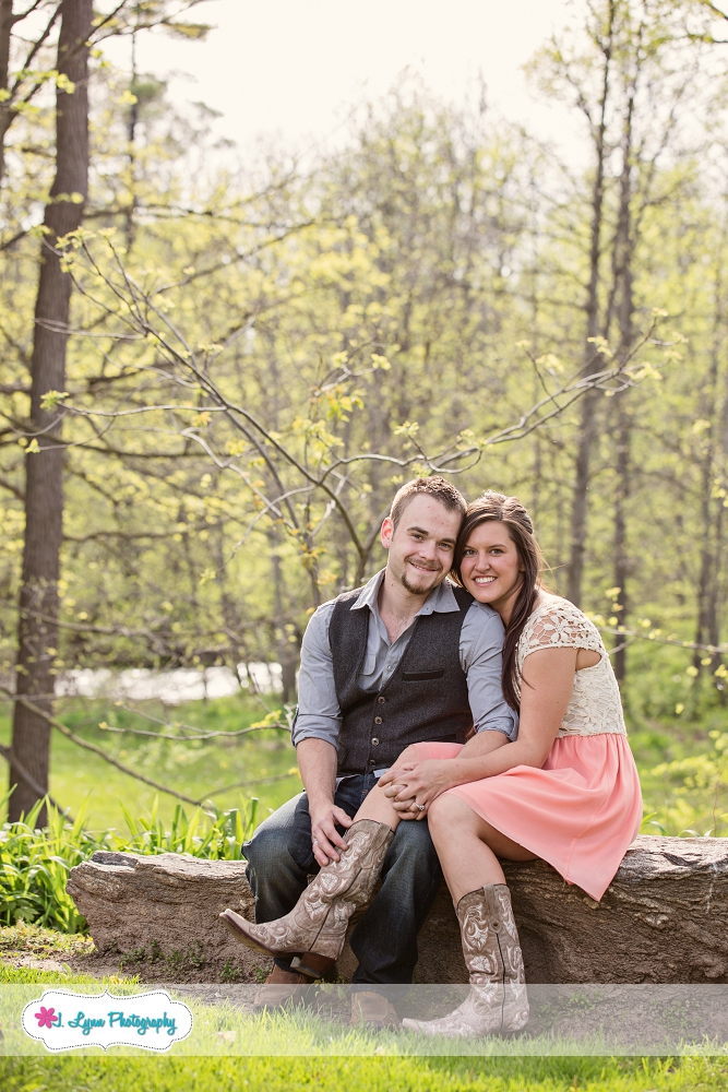 couple sitting on rock in woods